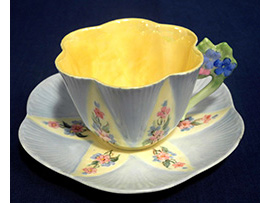 Blue and yellow floral handled Dainty cup and sauce