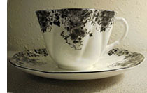 Dainty Black cup and saucer