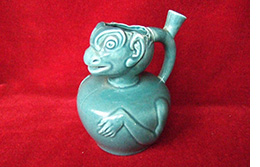 Green grotesque jug