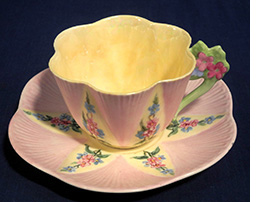 Pink and yellow floral Handled Dainty cup and saucer