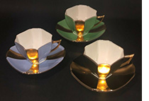 3 queen anne cups and saucers with goold panels